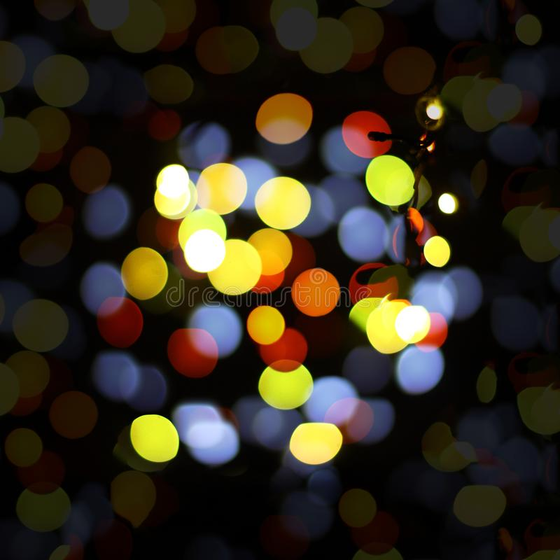 Christmas and happy new year on a blurred bokeh. Glare blurred blank background stock photography