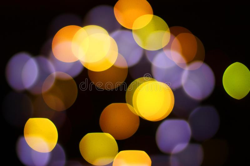 Christmas and happy new year on a blurred bokeh. Glare blurred blank background stock image