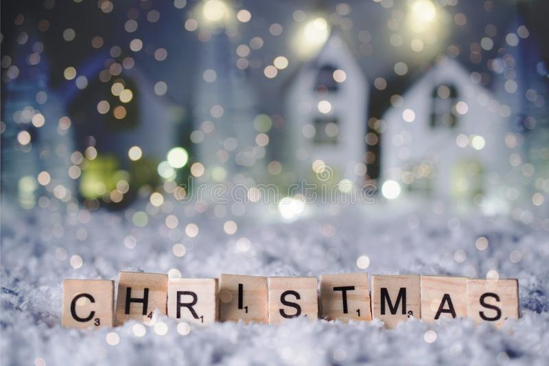 Christmas and Happy new year 2019. Christmas word from letters over blur bokeh background with copy space for text and snowfall. royalty free stock photos
