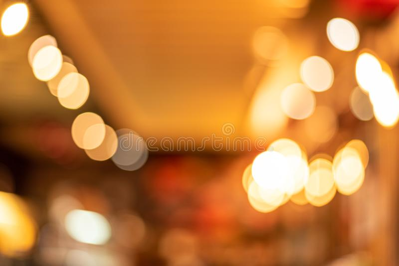 Christmas and Happy new year  concept . Blurred of gold abstract background with bokeh defocused lights for greeting card stock images