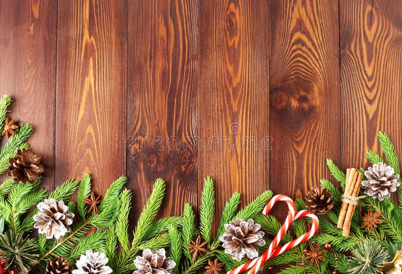 Christmas and Happy New Year dark brown background. Top view, copy space, wooden rustic table, fir branches stock photos