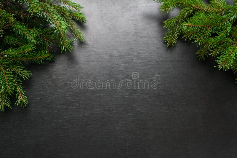 Christmas and Happy New Year holiday background with natural fir spruce, on black background, Winter Greeting Card concept with stock photography