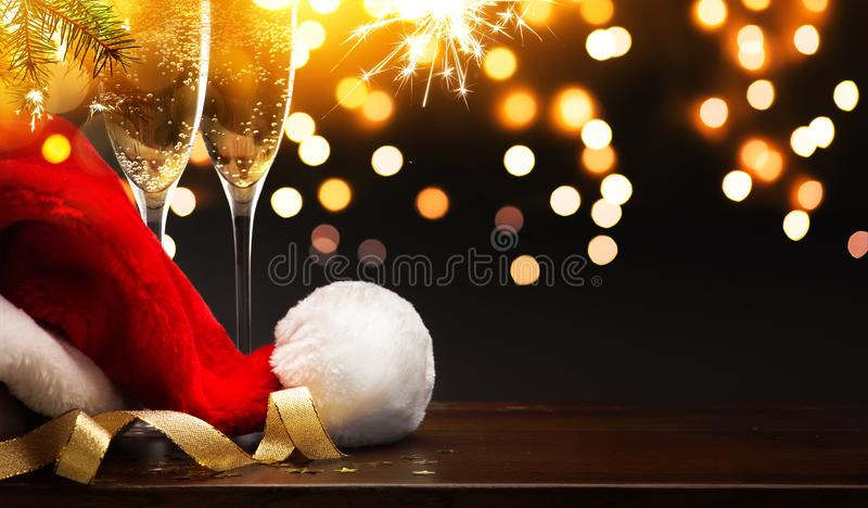Christmas and happy New year party background; champagne and San. Art Christmas and happy New year party background; champagne and Santa hat stock image