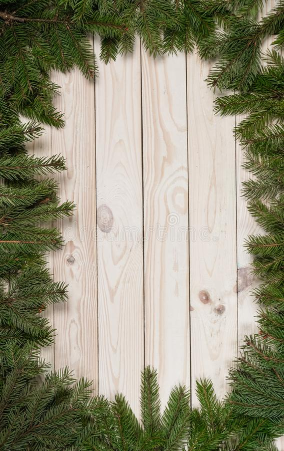 Christmas and happy New year. Rustic style. Christmas and happy New year. On a wooden background juicy spruce branches, Christmas decorations, cones. Rustic royalty free stock image