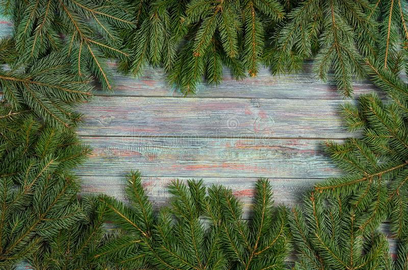 Christmas and happy New year. Rustic style. Christmas and happy New year. On a dark wooden background juicy spruce branches, Christmas decorations, cones stock photo