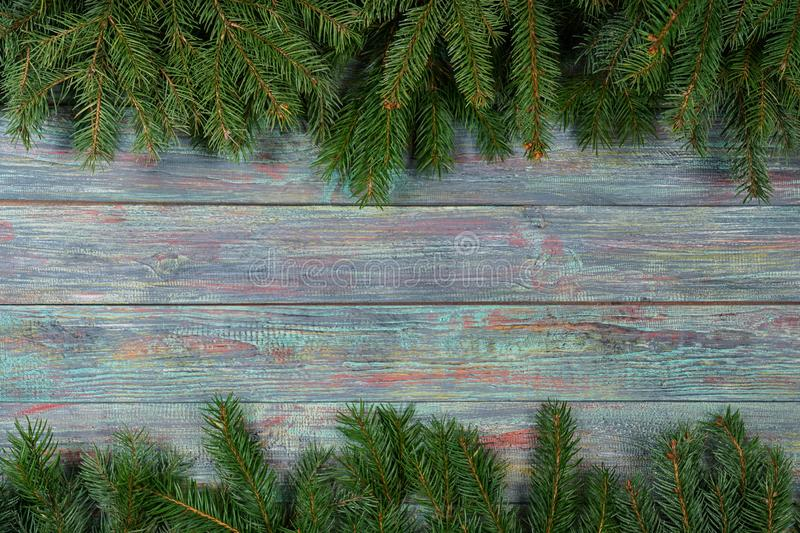 Christmas and happy New year. Rustic style. Christmas and happy New year. On a dark wooden background juicy spruce branches, Christmas decorations, cones stock photos