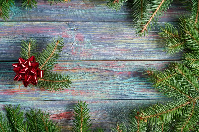 Christmas and happy New year. Rustic style. Christmas and happy New year. On a dark wooden background juicy spruce branches, Christmas decorations, cones stock photography