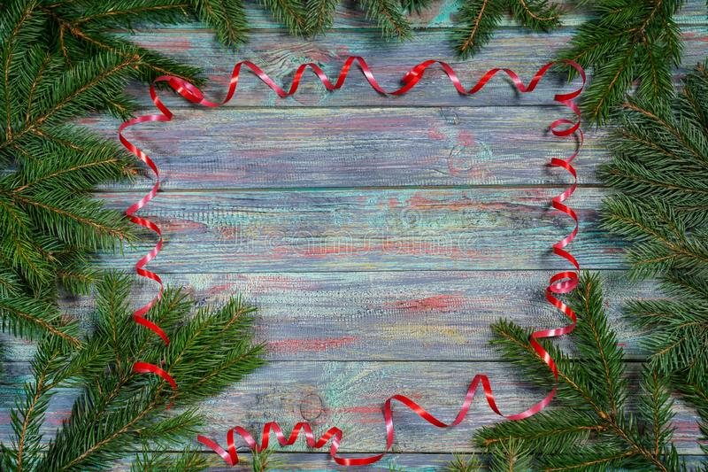 Christmas and happy New year. Rustic style. Christmas and happy New year. On a dark wooden background juicy spruce branches, Christmas decorations, cones. Rustic royalty free stock image