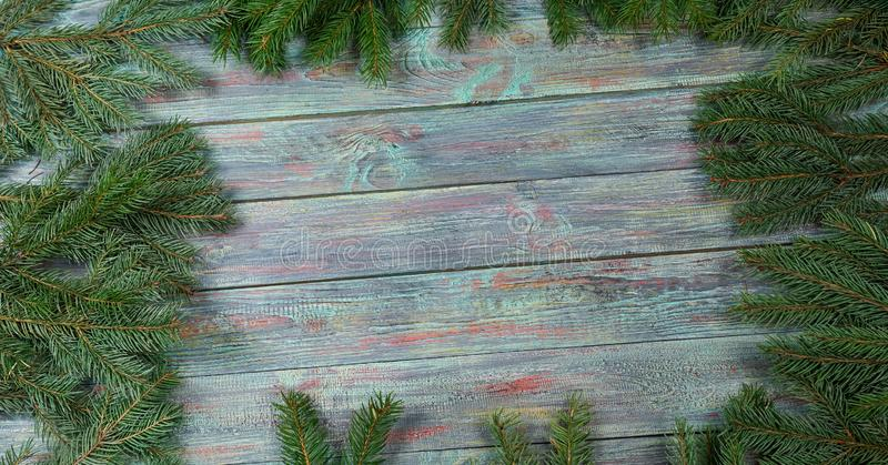 Christmas and happy New year. Rustic style. Christmas and happy New year. On a dark wooden background juicy spruce branches, Christmas decorations, cones. Rustic royalty free stock photo