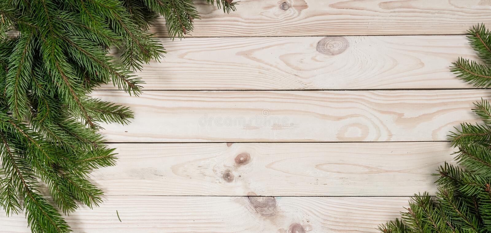Christmas and happy New year. Rustic style. Christmas and happy New year. On a wooden background juicy spruce branches, Christmas decorations, cones. Rustic royalty free stock photography