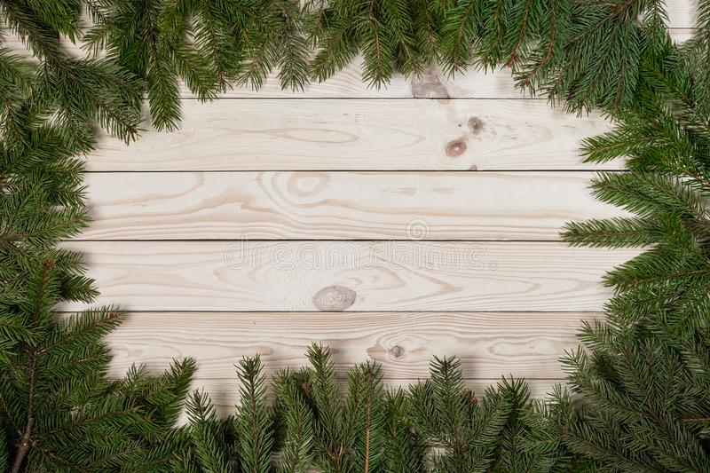 Christmas and happy New year. Rustic style. Christmas and happy New year. On a wooden background juicy spruce branches, Christmas decorations, cones. Rustic royalty free stock photo