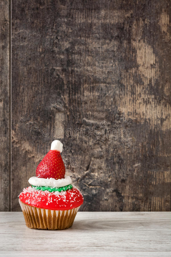 Christmas hat cupcake on wooden background royalty free stock images