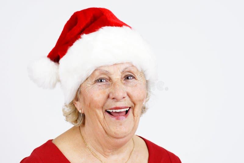 Christmas hat grandma smiling stock photo