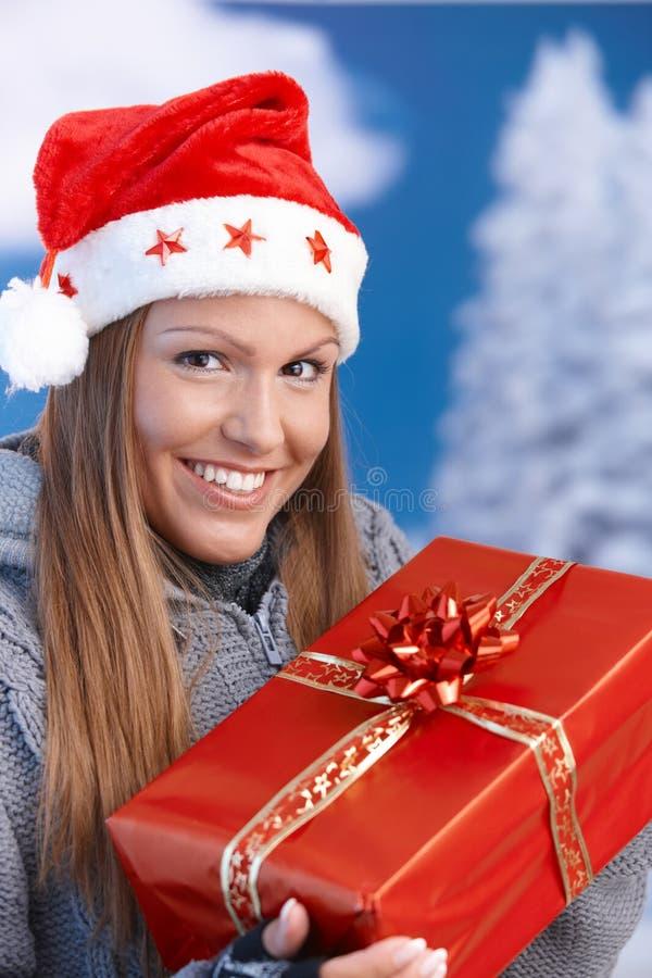 christmas hat holding present santa woman royaltyfria foton