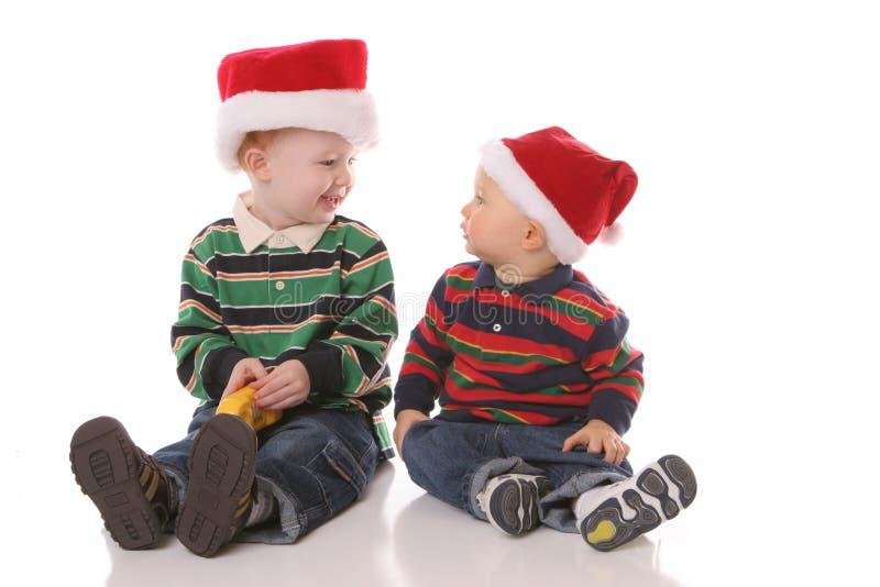 Christmas hat siblings royalty free stock images