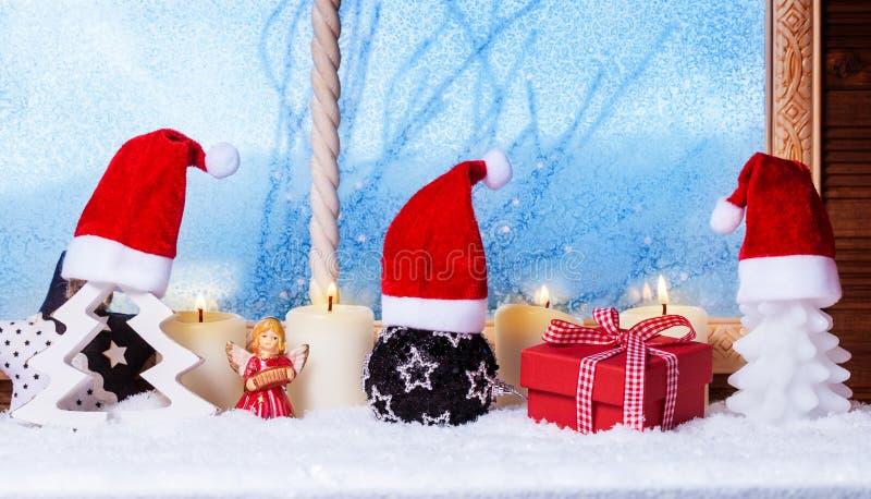 Christmas hats, candles, gift, angel stock image