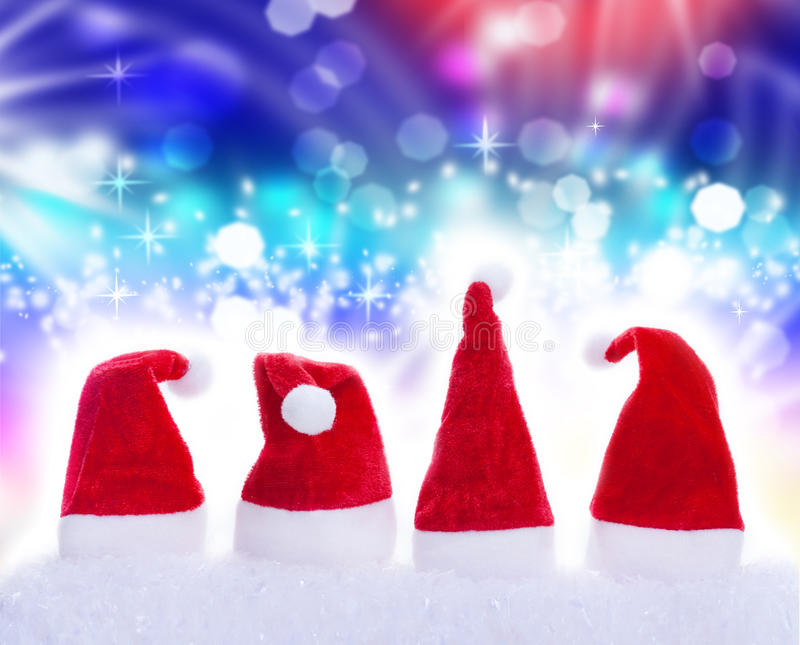 Christmas hats, snow, stars. Christmas hats in snow with snowstars royalty free stock image