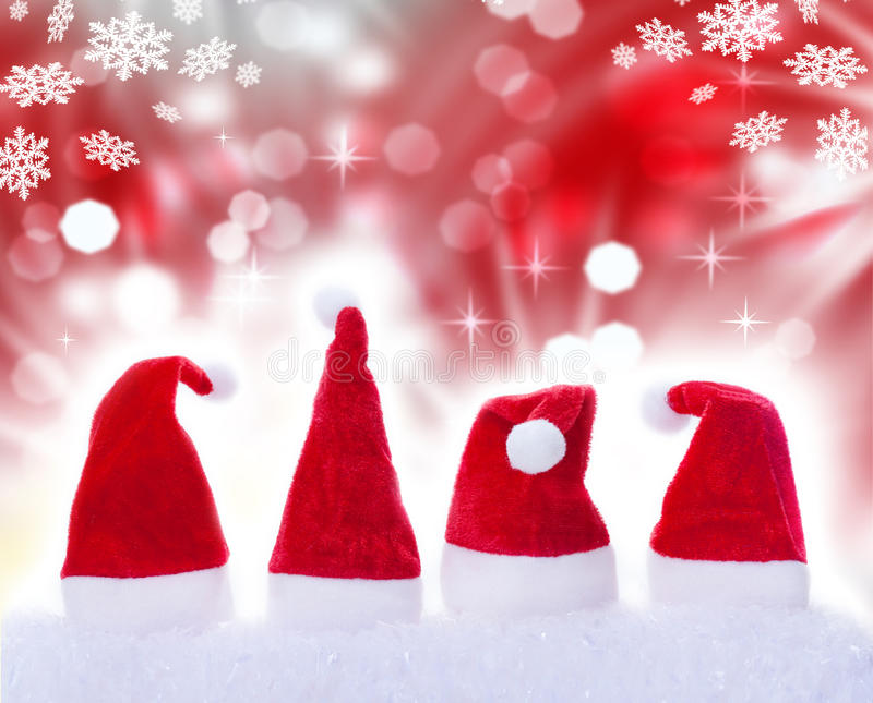 Christmas hats, snow, stars. Christmas hats and snowstars in snow royalty free stock image