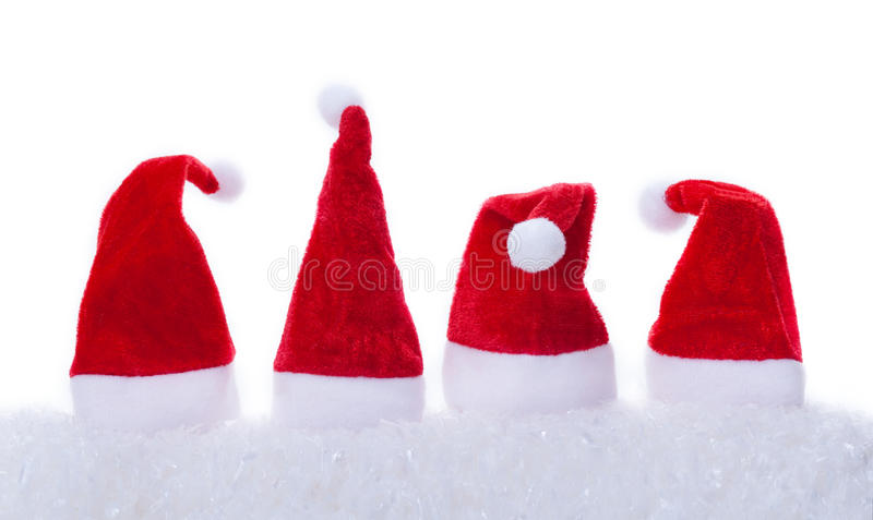 Christmas hats, snow, white background. Christmas hats with snow on white background royalty free stock images