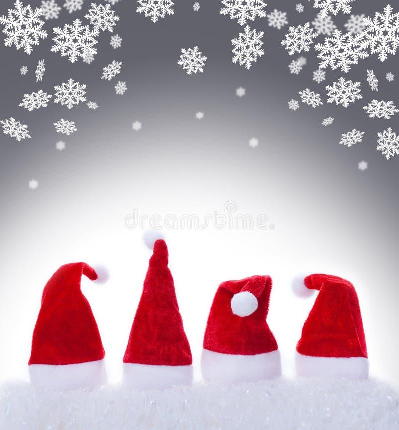 Christmas hats and snowflakes. Christmas hats, Santa hats and snowflakes royalty free stock photo