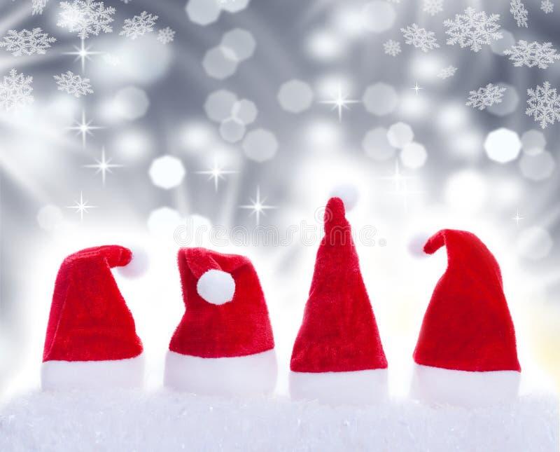 Christmas hats and snowflakes. Christmas hats, Santa hats and snowflakes royalty free stock photos