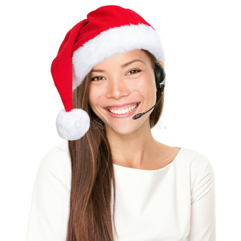 Christmas headset woman. From telemarketing call center wearing red santa hat talking smiling isolated on white background royalty free stock images