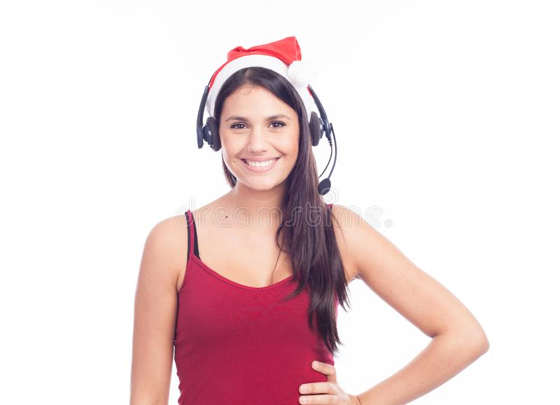 Christmas headset woman from telemarketing call center wearing red santa hat talking smiling isolated royalty free stock photos