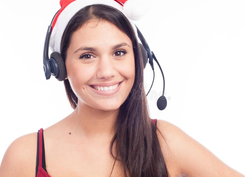 Christmas headset woman from telemarketing call center wearing red santa hat talking smiling. Isolated on white background royalty free stock images