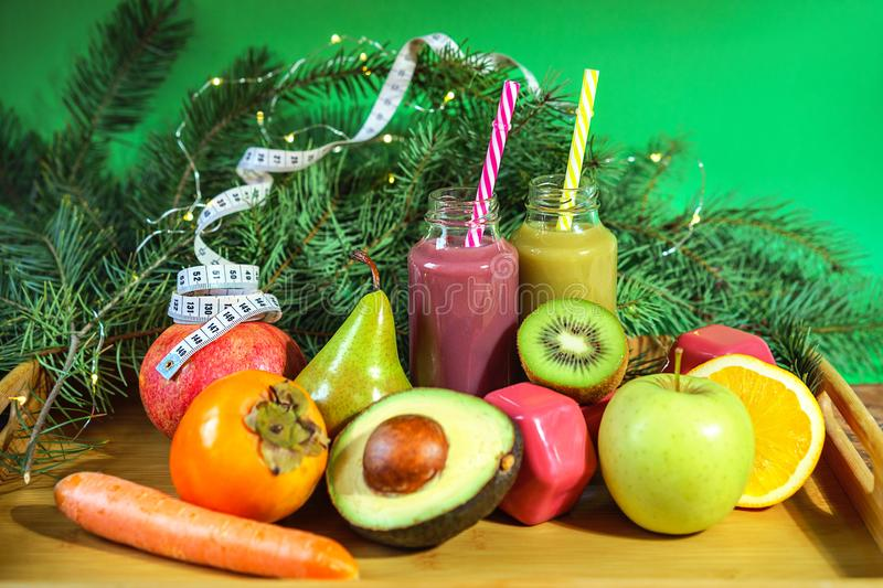 Christmas healthcare concept. Lifestyle fruits and vegetables. Keto diet food ingredient bottles smoothies acai berry measuring royalty free stock photo