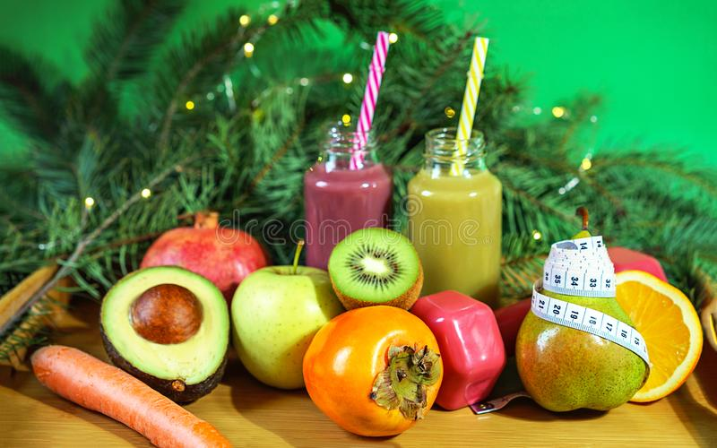 Christmas healthcare concept. Lifestyle fruits and vegetables. Keto diet food ingredient bottles smoothies acai berry measuring. Christmas healthy concept fruits stock images