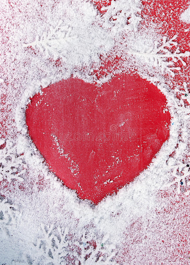 Christmas heart. Christmas background with place for message in snow in shape heart royalty free stock photography