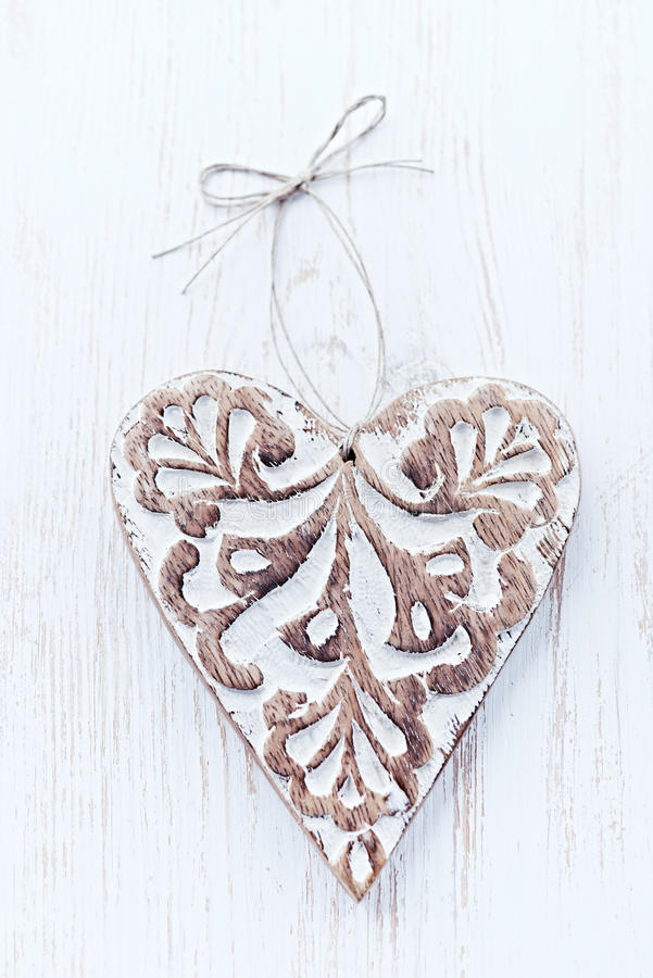 Christmas Heart. Rustic wooden christmas heart on white painted wood stock image