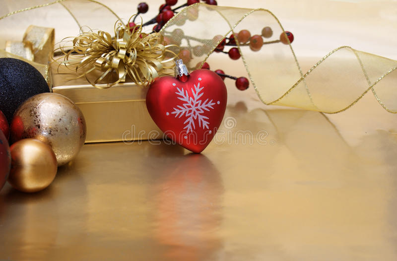 Christmas heart background. Christmas background with a heart shaped bauble stock photography