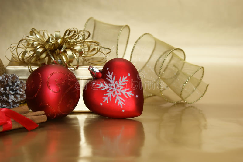 Christmas heart bauble background. Christmas background with a heart shaped bauble stock image