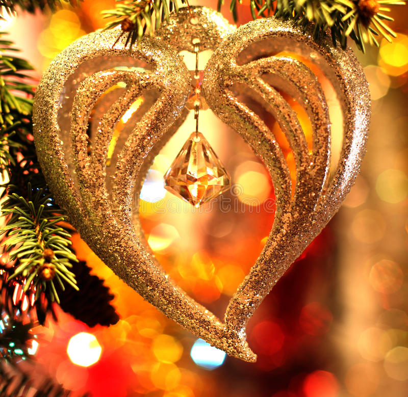 Christmas heart decoration. On holiday background with bell and pine tree twigs royalty free stock photos