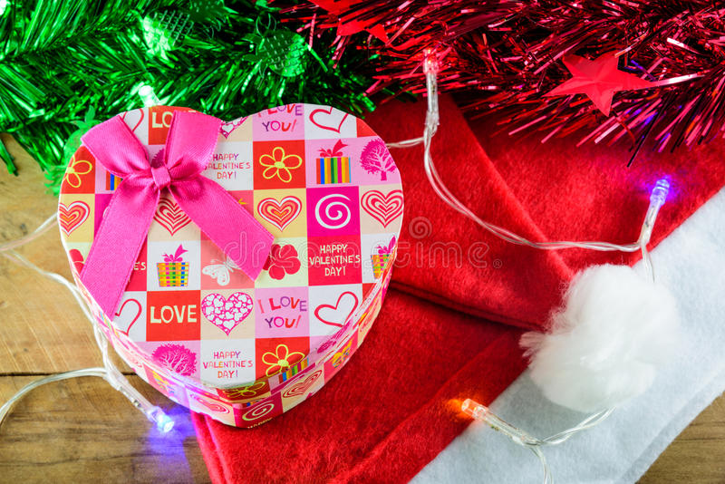 Christmas Heart gift box and decorations on wooden. Background stock photos