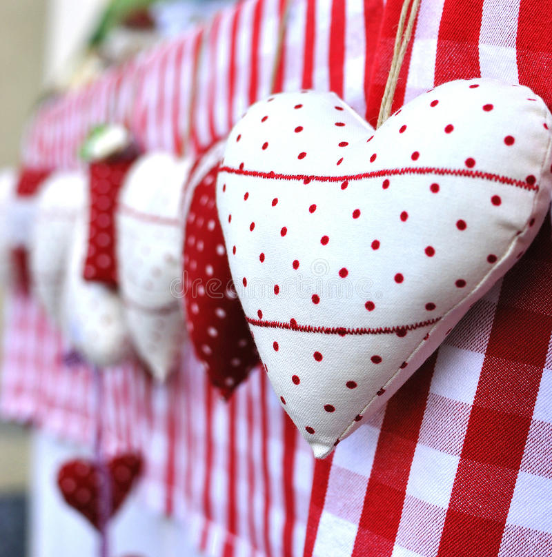 Christmas heart gifts. Background image of amazing handmade Christmas heart gifts in market stall, Milan, Italy royalty free stock image