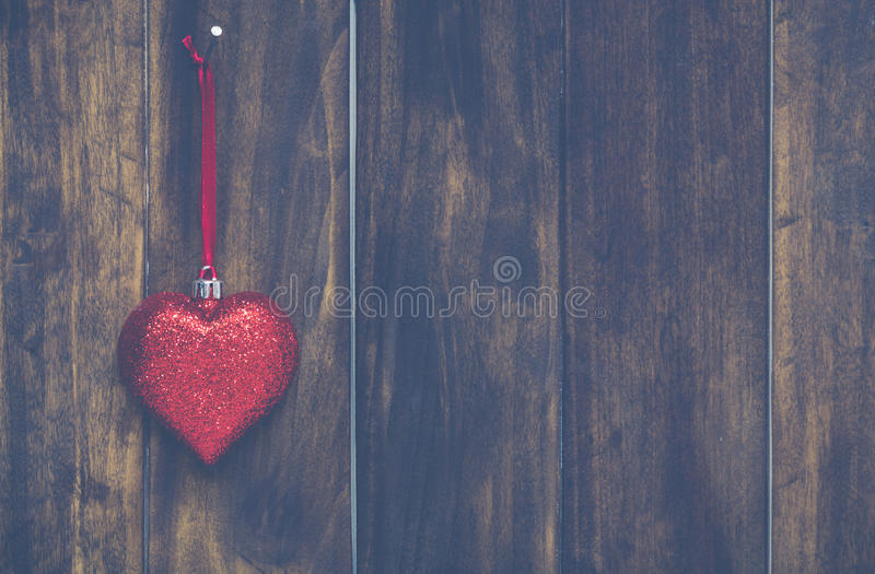 Christmas heart hanging. On a rustic wooden wall royalty free stock image