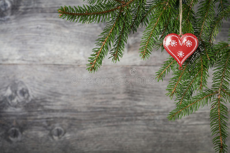 Christmas heart. Red Christmas heart on wooden background stock photos