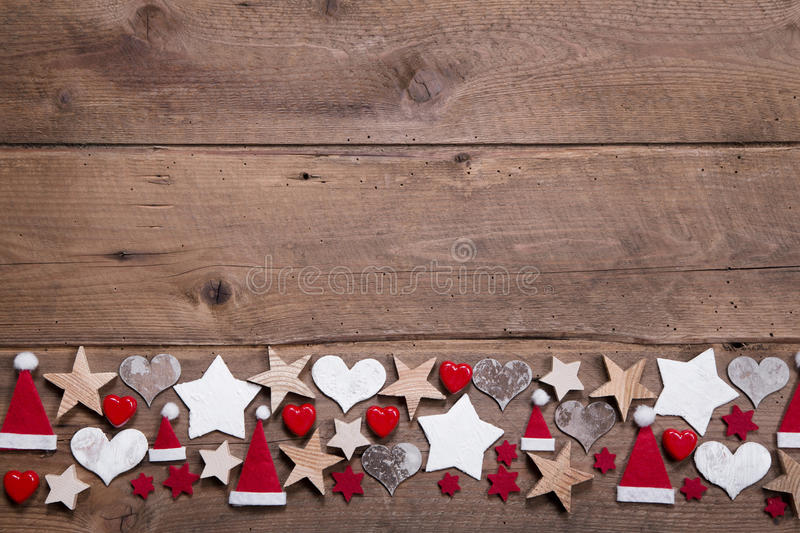 Christmas heart and stars decoration as border or frame on wooden background stock photo