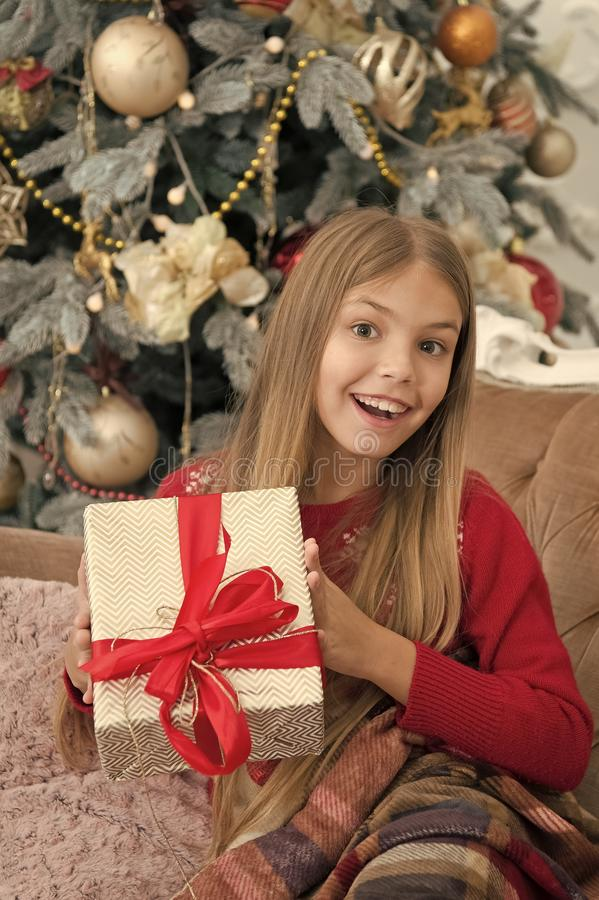 Christmas is here. xmas online shopping. Family holiday. Happy new year. Winter. The morning before Xmas. Little girl. Christmas tree and presents. Child enjoy royalty free stock image