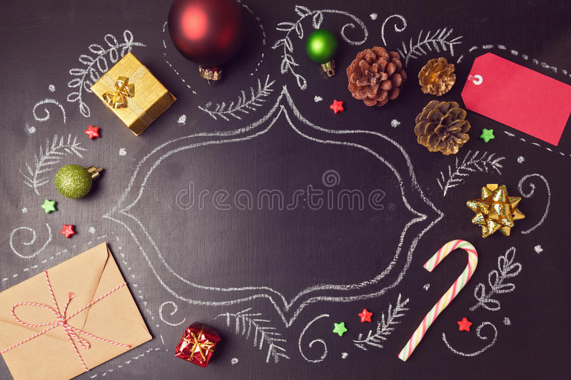Christmas holiday background with decorations and hand drawings on chalkboard. View from above. Christmas holiday background with decorations and hand drawings royalty free stock photo