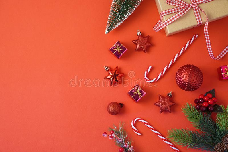 Christmas holiday background with decorations and ornaments on r. Ed table. Top view from above stock photography