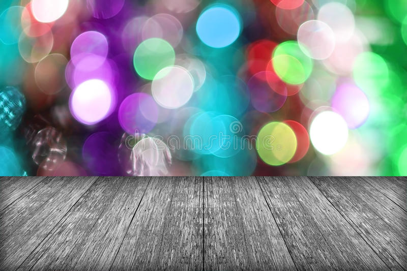Christmas holiday background with empty wooden deck table over w stock photography