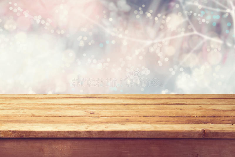 Christmas holiday background with empty wooden deck table over winter bokeh. Ready for product montage stock photo