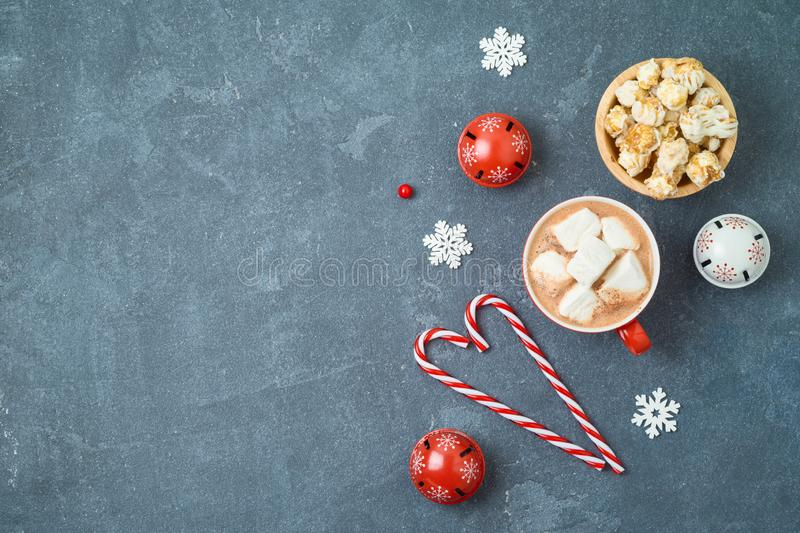 Christmas holiday background with hot chocolate cup and caramel pop corn on blackboard. Top view from above royalty free stock photo