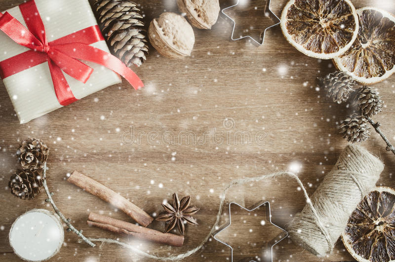 Christmas Holiday Background. Rustic Xmas Decorations on Wooden Background. Vintage Image with Drawn Snowfall. royalty free stock images