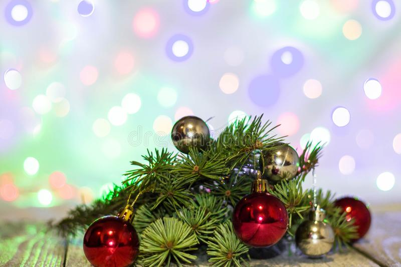 Christmas holiday background. Silver and red bauble hanging from a decorated on tree with bokeh, copy space stock image