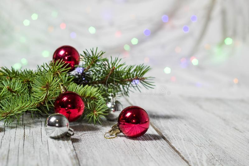 Christmas holiday background. Silver and red bauble hanging from a decorated on tree with bokeh, copy space stock photo