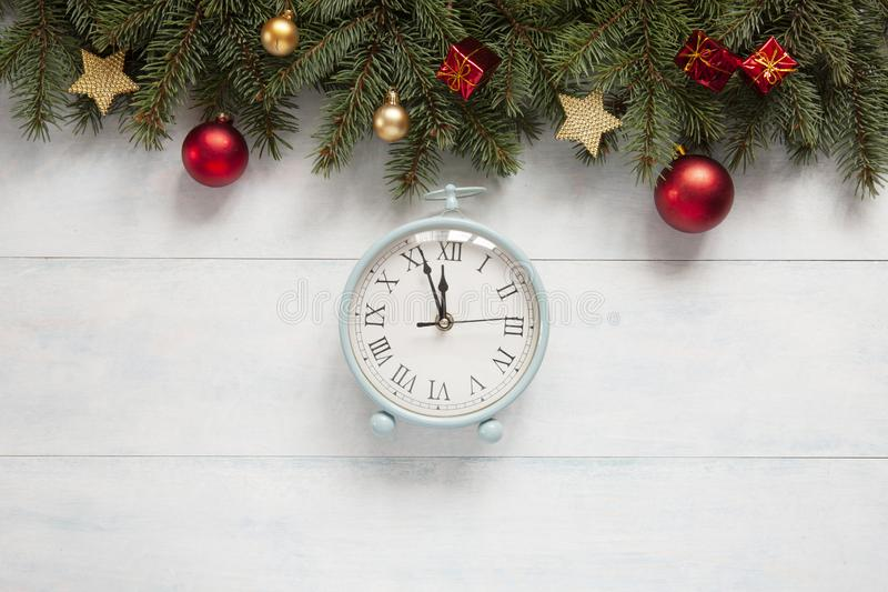 Christmas holiday background with vintage alarm-clock, balls royalty free stock images